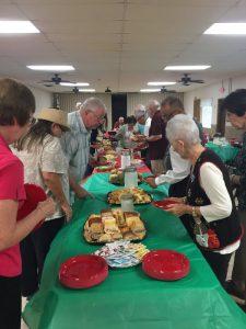 People gathered around Christmas table